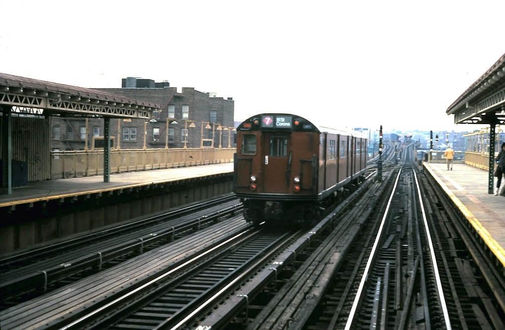 (154k, 1024x670)<br><b>Country:</b> United States<br><b>City:</b> New York<br><b>System:</b> New York City Transit<br><b>Line:</b> IRT Flushing Line<br><b>Location:</b> 69th Street/Fisk Avenue <br><b>Car:</b> R-36 World's Fair (St. Louis, 1963-64)  <br><b>Collection of:</b> John Barnes<br><b>Date:</b> 3/11/1985<br><b>Viewed (this week/total):</b> 1 / 1985