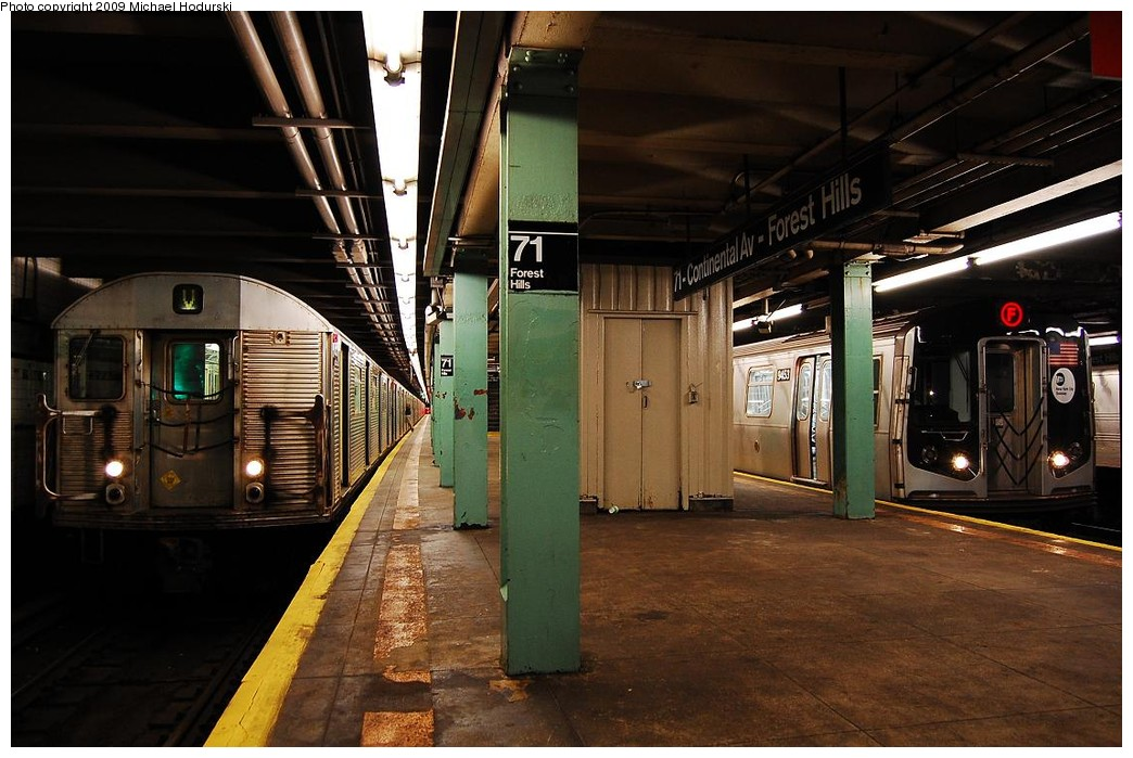 (224k, 1044x699)<br><b>Country:</b> United States<br><b>City:</b> New York<br><b>System:</b> New York City Transit<br><b>Line:</b> IND Queens Boulevard Line<br><b>Location:</b> 71st/Continental Aves./Forest Hills <br><b>Route:</b> V<br><b>Car:</b> R-32 (Budd, 1964)  3511 <br><b>Photo by:</b> Michael Hodurski<br><b>Date:</b> 12/10/2009<br><b>Notes:</b> With R160 9453<br><b>Viewed (this week/total):</b> 2 / 1106