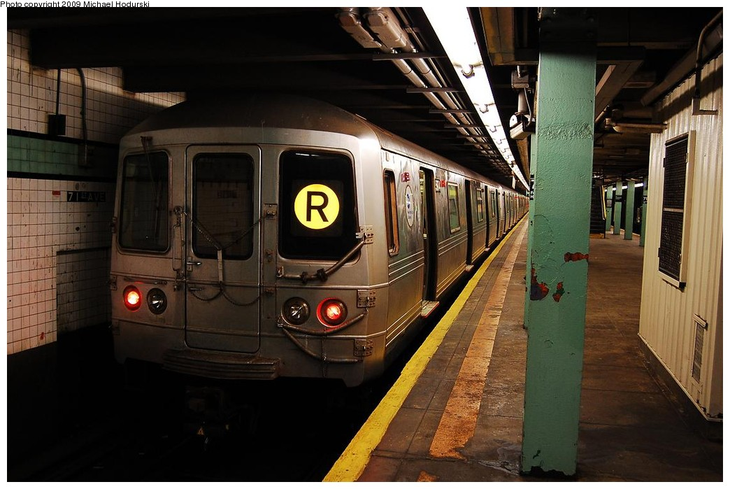 (219k, 1044x699)<br><b>Country:</b> United States<br><b>City:</b> New York<br><b>System:</b> New York City Transit<br><b>Line:</b> IND Queens Boulevard Line<br><b>Location:</b> 71st/Continental Aves./Forest Hills <br><b>Route:</b> R<br><b>Car:</b> R-46 (Pullman-Standard, 1974-75) 5974 <br><b>Photo by:</b> Michael Hodurski<br><b>Date:</b> 12/10/2009<br><b>Viewed (this week/total):</b> 0 / 598