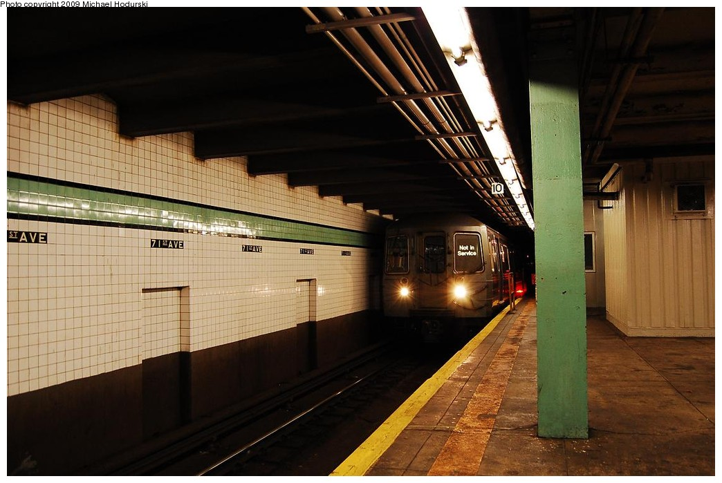(210k, 1044x699)<br><b>Country:</b> United States<br><b>City:</b> New York<br><b>System:</b> New York City Transit<br><b>Line:</b> IND Queens Boulevard Line<br><b>Location:</b> 71st/Continental Aves./Forest Hills <br><b>Car:</b> R-68/R-68A Series (Number Unknown)  <br><b>Photo by:</b> Michael Hodurski<br><b>Date:</b> 12/10/2009<br><b>Viewed (this week/total):</b> 8 / 1661