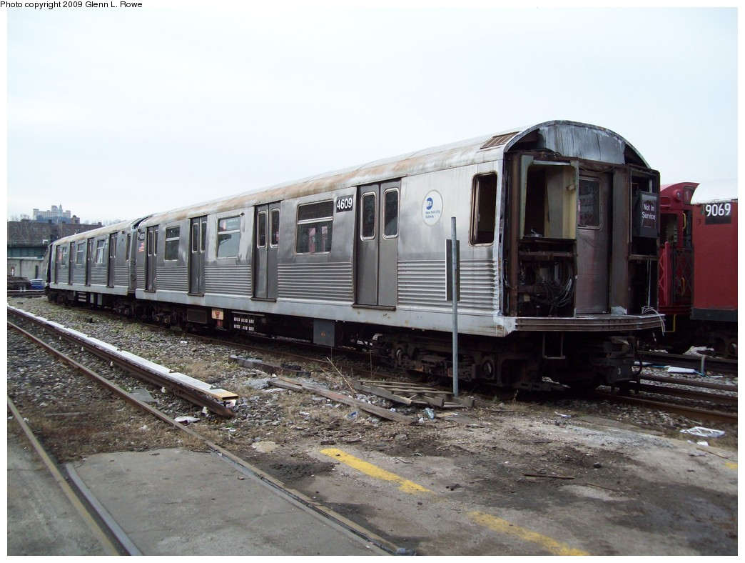(209k, 1044x788)<br><b>Country:</b> United States<br><b>City:</b> New York<br><b>System:</b> New York City Transit<br><b>Location:</b> 207th Street Yard<br><b>Car:</b> R-38 (St. Louis, 1966-1967)  4069 <br><b>Photo by:</b> Glenn L. Rowe<br><b>Date:</b> 12/7/2009<br><b>Notes:</b> Scrap<br><b>Viewed (this week/total):</b> 2 / 605