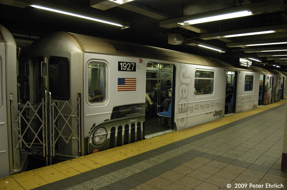 (185k, 930x618)<br><b>Country:</b> United States<br><b>City:</b> New York<br><b>System:</b> New York City Transit<br><b>Line:</b> IRT Times Square-Grand Central Shuttle<br><b>Location:</b> Grand Central <br><b>Car:</b> R-62A (Bombardier, 1984-1987)  1927 <br><b>Photo by:</b> Peter Ehrlich<br><b>Date:</b> 12/6/2009<br><b>Notes:</b> With Jeep shrinkwrap adverts.<br><b>Viewed (this week/total):</b> 1 / 561