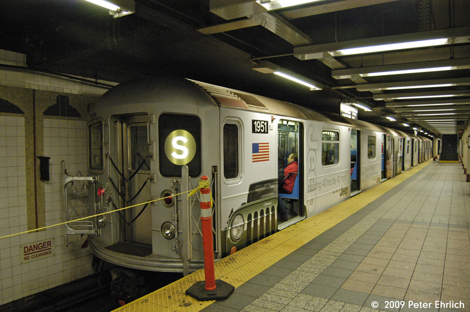 (205k, 930x618)<br><b>Country:</b> United States<br><b>City:</b> New York<br><b>System:</b> New York City Transit<br><b>Line:</b> IRT Times Square-Grand Central Shuttle<br><b>Location:</b> Grand Central <br><b>Car:</b> R-62A (Bombardier, 1984-1987)  1951 <br><b>Photo by:</b> Peter Ehrlich<br><b>Date:</b> 12/6/2009<br><b>Notes:</b> With Jeep shrinkwrap adverts.<br><b>Viewed (this week/total):</b> 0 / 902