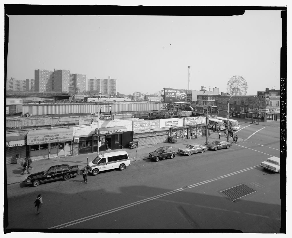 (116k, 1024x837)<br><b>Country:</b> United States<br><b>City:</b> New York<br><b>System:</b> New York City Transit<br><b>Location:</b> Coney Island/Stillwell Avenue<br><b>Photo by:</b> Rob Tucher, Historic American Engineering Record<br><b>Collection of:</b> Library of Congress, Prints and Photographs Division<br><b>Notes:</b> Elevated view toward corner of Stillwell Avenue and Surf Avenue showing association with Coney Island Amusement Park. Looking southeast.<br><b>Viewed (this week/total):</b> 1 / 734