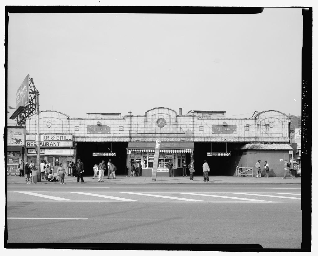 (108k, 1024x825)<br><b>Country:</b> United States<br><b>City:</b> New York<br><b>System:</b> New York City Transit<br><b>Location:</b> Coney Island/Stillwell Avenue<br><b>Photo by:</b> Rob Tucher, Historic American Engineering Record<br><b>Collection of:</b> Library of Congress, Prints and Photographs Division<br><b>Notes:</b> South facade of Stillwell Avenue station facing Surf Avenue. Looking north.<br><b>Viewed (this week/total):</b> 1 / 854