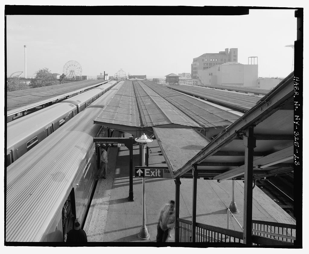(138k, 1024x841)<br><b>Country:</b> United States<br><b>City:</b> New York<br><b>System:</b> New York City Transit<br><b>Location:</b> Coney Island/Stillwell Avenue<br><b>Photo by:</b> Rob Tucher, Historic American Engineering Record<br><b>Collection of:</b> Library of Congress, Prints and Photographs Division<br><b>Notes:</b> View toward Coney Island Amusement Park across platform canopies and trains from RTO building elevated platform. Looking south.<br><b>Viewed (this week/total):</b> 0 / 827