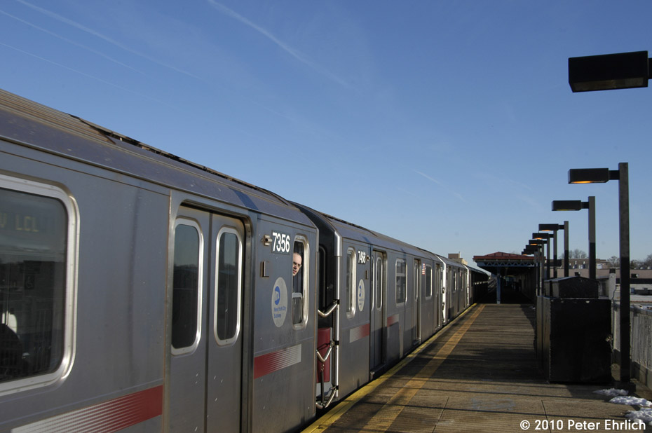 (116k, 930x618)<br><b>Country:</b> United States<br><b>City:</b> New York<br><b>System:</b> New York City Transit<br><b>Line:</b> IRT Pelham Line<br><b>Location:</b> Zerega Avenue <br><b>Route:</b> 6<br><b>Car:</b> R-142A (Primary Order, Kawasaki, 1999-2002)  7356+7466 <br><b>Photo by:</b> Peter Ehrlich<br><b>Date:</b> 1/6/2010<br><b>Notes:</b> Coupled cars arriving Zerega Avenue outbound.<br><b>Viewed (this week/total):</b> 2 / 462