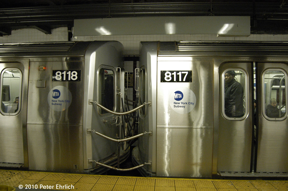 (174k, 930x618)<br><b>Country:</b> United States<br><b>City:</b> New York<br><b>System:</b> New York City Transit<br><b>Line:</b> BMT Canarsie Line<br><b>Location:</b> 8th Avenue <br><b>Route:</b> L<br><b>Car:</b> R-143 (Kawasaki, 2001-2002) 8118+8117 <br><b>Photo by:</b> Peter Ehrlich<br><b>Date:</b> 1/6/2010<br><b>Notes:</b> Coupled cars.<br><b>Viewed (this week/total):</b> 1 / 1262