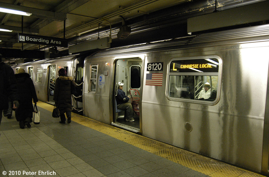(188k, 930x614)<br><b>Country:</b> United States<br><b>City:</b> New York<br><b>System:</b> New York City Transit<br><b>Line:</b> BMT Canarsie Line<br><b>Location:</b> 8th Avenue <br><b>Route:</b> L<br><b>Car:</b> R-143 (Kawasaki, 2001-2002) 8120 <br><b>Photo by:</b> Peter Ehrlich<br><b>Date:</b> 1/6/2010<br><b>Viewed (this week/total):</b> 0 / 653