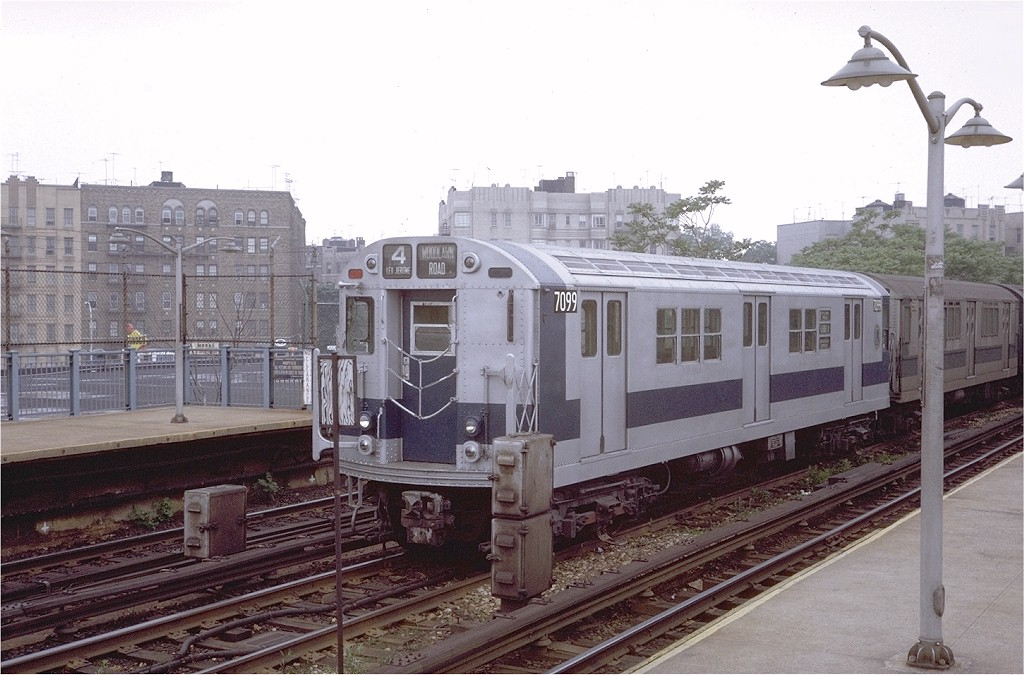 (192k, 1024x675)<br><b>Country:</b> United States<br><b>City:</b> New York<br><b>System:</b> New York City Transit<br><b>Line:</b> IRT Woodlawn Line<br><b>Location:</b> Bedford Park Boulevard <br><b>Route:</b> 4<br><b>Car:</b> R-21 (St. Louis, 1956-57) 7099 <br><b>Photo by:</b> Steve Zabel<br><b>Collection of:</b> Joe Testagrose<br><b>Date:</b> 6/1/1971<br><b>Viewed (this week/total):</b> 2 / 2249
