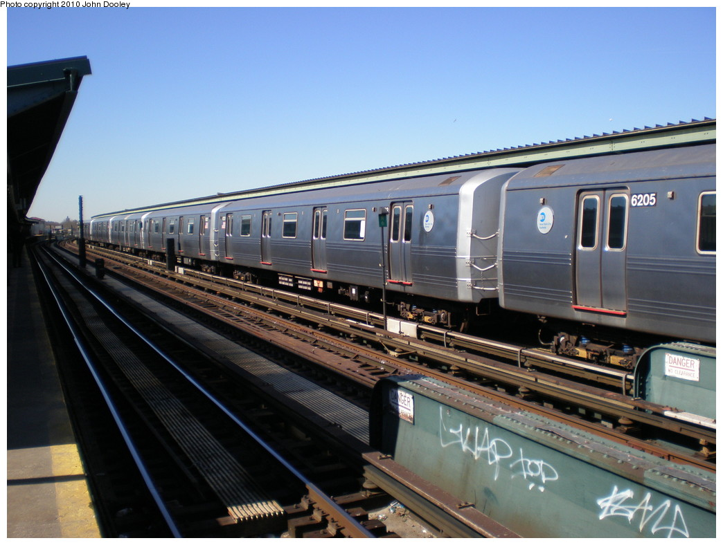 (214k, 1044x788)<br><b>Country:</b> United States<br><b>City:</b> New York<br><b>System:</b> New York City Transit<br><b>Line:</b> IND Fulton Street Line<br><b>Location:</b> Rockaway Boulevard <br><b>Route:</b> A<br><b>Car:</b> R-46 (Pullman-Standard, 1974-75) 6203 <br><b>Photo by:</b> John Dooley<br><b>Date:</b> 3/6/2010<br><b>Viewed (this week/total):</b> 2 / 253