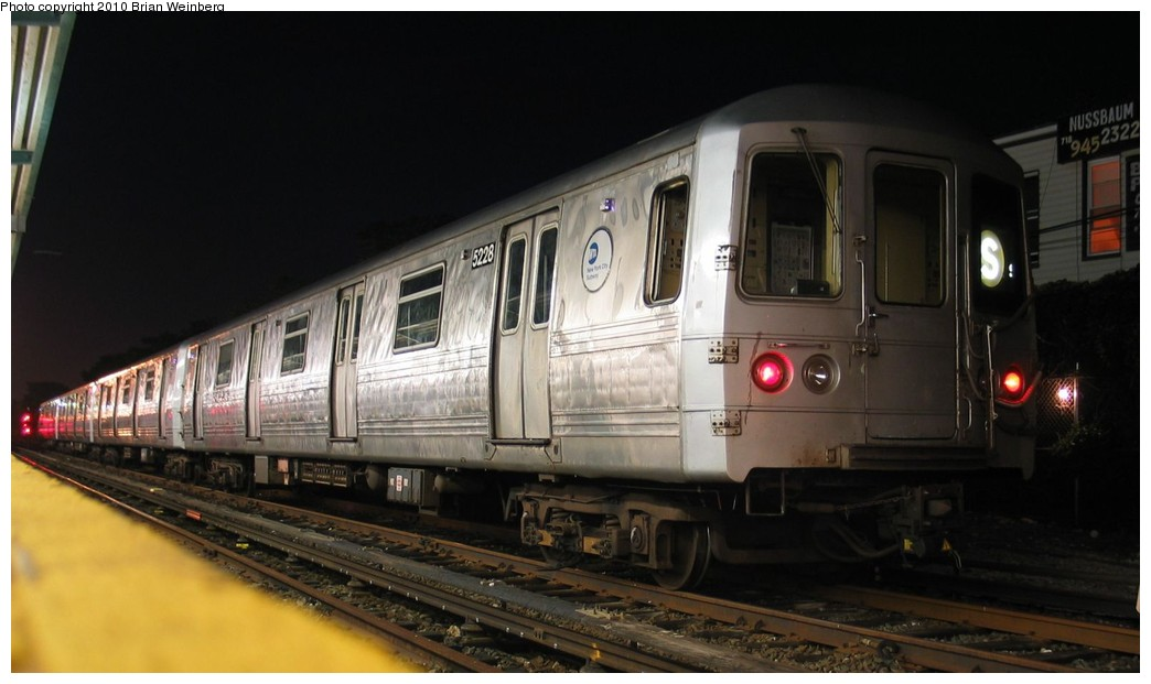 (135k, 1044x621)<br><b>Country:</b> United States<br><b>City:</b> New York<br><b>System:</b> New York City Transit<br><b>Location:</b> Rockaway Park Yard<br><b>Route:</b> A<br><b>Car:</b> R-44 (St. Louis, 1971-73) 5228 <br><b>Photo by:</b> Brian Weinberg<br><b>Date:</b> 7/24/2003<br><b>Notes:</b> Note this car has a stainless steel belly band.<br><b>Viewed (this week/total):</b> 0 / 944