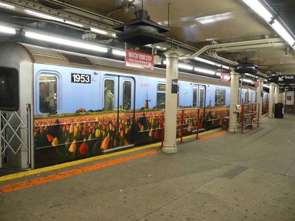 (140k, 1024x768)<br><b>Country:</b> United States<br><b>City:</b> New York<br><b>System:</b> New York City Transit<br><b>Line:</b> IRT Times Square-Grand Central Shuttle<br><b>Location:</b> Times Square <br><b>Route:</b> S<br><b>Car:</b> R-62A (Bombardier, 1984-1987)  1953 <br><b>Photo by:</b> Robbie Rosenfeld<br><b>Date:</b> 2/22/2010<br><b>Notes:</b> Holland travel advertisement.<br><b>Viewed (this week/total):</b> 2 / 857