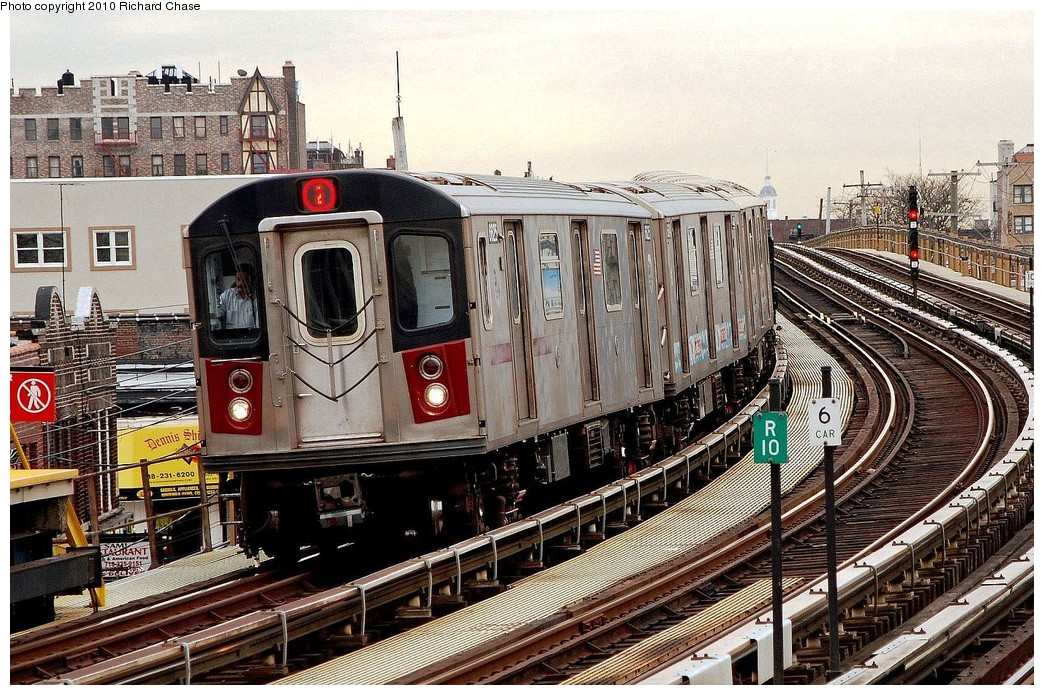 (292k, 1044x695)<br><b>Country:</b> United States<br><b>City:</b> New York<br><b>System:</b> New York City Transit<br><b>Line:</b> IRT White Plains Road Line<br><b>Location:</b> 238th Street (Nereid Avenue) <br><b>Route:</b> 2<br><b>Car:</b> R-142 or R-142A (Number Unknown)  <br><b>Photo by:</b> Richard Chase<br><b>Date:</b> 3/25/2010<br><b>Viewed (this week/total):</b> 2 / 1019