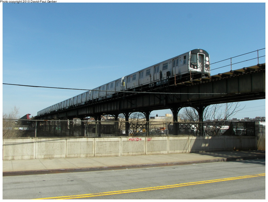 (238k, 1044x788)<br><b>Country:</b> United States<br><b>City:</b> New York<br><b>System:</b> New York City Transit<br><b>Line:</b> BMT Canarsie Line<br><b>Location:</b> Sutter Avenue <br><b>Route:</b> L<br><b>Car:</b> R-143 (Kawasaki, 2001-2002)  <br><b>Photo by:</b> David-Paul Gerber<br><b>Date:</b> 4/3/2010<br><b>Notes:</b> On Blake Ave at Junius Street, one block south of station. Rockaway Parkway-bound train.<br><b>Viewed (this week/total):</b> 3 / 573
