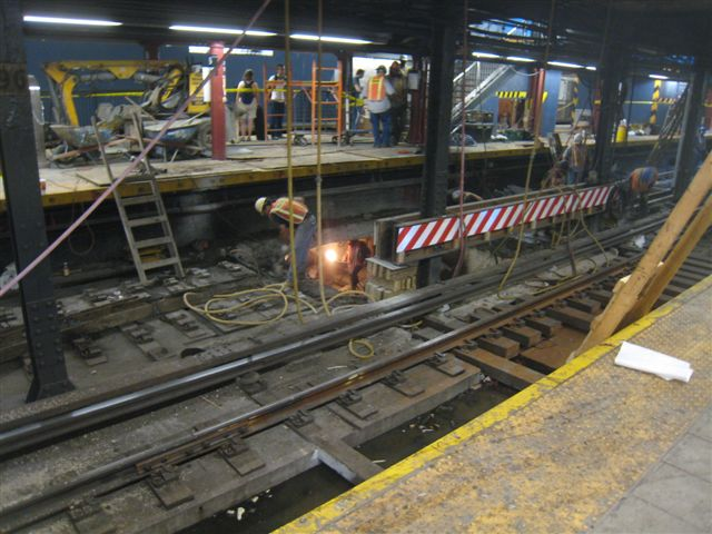 (71k, 640x480)<br><b>Country:</b> United States<br><b>City:</b> New York<br><b>System:</b> New York City Transit<br><b>Line:</b> IRT West Side Line<br><b>Location:</b> 96th Street <br><b>Photo by:</b> David Blair<br><b>Date:</b> 6/19/2010<br><b>Notes:</b> Note workers in passageway under platform.<br><b>Viewed (this week/total):</b> 6 / 1764