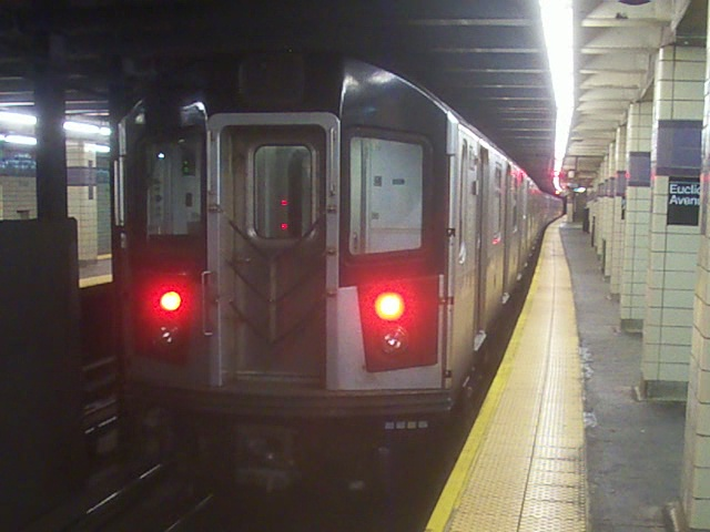 (118k, 640x480)<br><b>Country:</b> United States<br><b>City:</b> New York<br><b>System:</b> New York City Transit<br><b>Line:</b> IND Fulton Street Line<br><b>Location:</b> Euclid Avenue <br><b>Car:</b> R-142A (Option Order, Kawasaki, 2002-2003)  7616 <br><b>Photo by:</b> Christopher Henderson<br><b>Date:</b> 7/15/2010<br><b>Notes:</b> Out of service IRT train being moved to Pitkin Yard - reason unknown.<br><b>Viewed (this week/total):</b> 5 / 1200