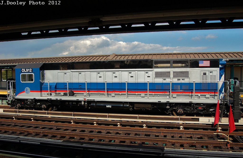 (328k, 1024x665)<br><b>Country:</b> United States<br><b>City:</b> New York<br><b>System:</b> New York City Transit<br><b>Line:</b> BMT West End Line<br><b>Location:</b> Bay 50th Street <br><b>Route:</b> Work Service<br><b>Car:</b> R-156 Diesel-Electric Locomotive (MPI, 2012-2013) 912 <br><b>Photo by:</b> John Dooley<br><b>Date:</b> 7/29/2012<br><b>Viewed (this week/total):</b> 0 / 1061