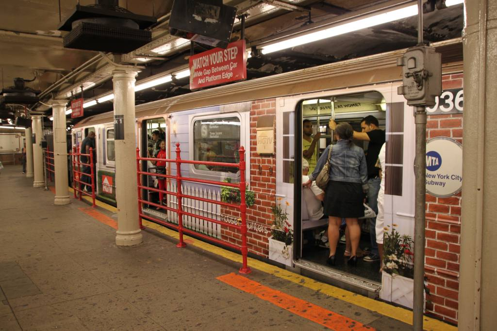 (137k, 1024x683)<br><b>Country:</b> United States<br><b>City:</b> New York<br><b>System:</b> New York City Transit<br><b>Line:</b> IRT Times Square-Grand Central Shuttle<br><b>Location:</b> Times Square <br><b>Route:</b> S<br><b>Car:</b> R-62A (Bombardier, 1984-1987)  1936 <br><b>Photo by:</b> Robbie Rosenfeld<br><b>Date:</b> 9/6/2010<br><b>Notes:</b> HGTV ad wrap<br><b>Viewed (this week/total):</b> 3 / 1476