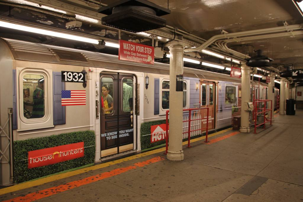 (129k, 1024x683)<br><b>Country:</b> United States<br><b>City:</b> New York<br><b>System:</b> New York City Transit<br><b>Line:</b> IRT Times Square-Grand Central Shuttle<br><b>Location:</b> Times Square <br><b>Route:</b> S<br><b>Car:</b> R-62A (Bombardier, 1984-1987)  1932 <br><b>Photo by:</b> Robbie Rosenfeld<br><b>Date:</b> 9/6/2010<br><b>Notes:</b> HGTV ad wrap<br><b>Viewed (this week/total):</b> 0 / 913