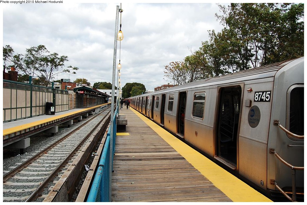 (289k, 1044x699)<br><b>Country:</b> United States<br><b>City:</b> New York<br><b>System:</b> New York City Transit<br><b>Line:</b> BMT Brighton Line<br><b>Location:</b> Avenue J <br><b>Route:</b> Q<br><b>Car:</b> R-160B (Kawasaki, 2005-2008)  8745 <br><b>Photo by:</b> Michael Hodurski<br><b>Date:</b> 10/15/2010<br><b>Notes:</b> Temporary platform<br><b>Viewed (this week/total):</b> 0 / 1006