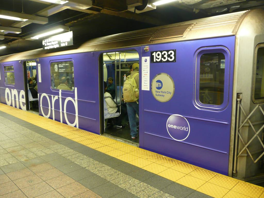 (135k, 1024x768)<br><b>Country:</b> United States<br><b>City:</b> New York<br><b>System:</b> New York City Transit<br><b>Line:</b> IRT Times Square-Grand Central Shuttle<br><b>Location:</b> Grand Central <br><b>Route:</b> S<br><b>Car:</b> R-62A (Bombardier, 1984-1987)  1933 <br><b>Photo by:</b> Robbie Rosenfeld<br><b>Date:</b> 10/4/2010<br><b>Notes:</b> Oneworld airlines ad wrap.<br><b>Viewed (this week/total):</b> 1 / 472