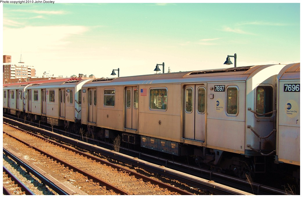 (234k, 1044x683)<br><b>Country:</b> United States<br><b>City:</b> New York<br><b>System:</b> New York City Transit<br><b>Line:</b> IRT Woodlawn Line<br><b>Location:</b> Bedford Park Boulevard <br><b>Route:</b> 4<br><b>Car:</b> R-142A (Option Order, Kawasaki, 2002-2003)  7697 <br><b>Photo by:</b> John Dooley<br><b>Date:</b> 10/28/2010<br><b>Viewed (this week/total):</b> 0 / 276