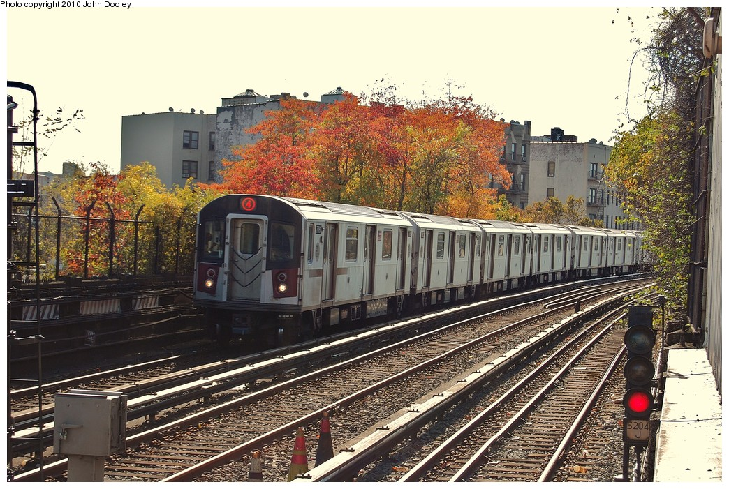 (330k, 1044x701)<br><b>Country:</b> United States<br><b>City:</b> New York<br><b>System:</b> New York City Transit<br><b>Line:</b> IRT Woodlawn Line<br><b>Location:</b> Bedford Park Boulevard <br><b>Route:</b> 4<br><b>Car:</b> R-142A (Supplemental Order, Kawasaki, 2003-2004)  7781 <br><b>Photo by:</b> John Dooley<br><b>Date:</b> 10/28/2010<br><b>Viewed (this week/total):</b> 1 / 1912
