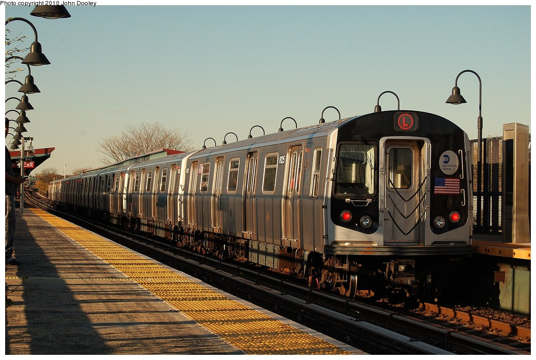 (257k, 1044x701)<br><b>Country:</b> United States<br><b>City:</b> New York<br><b>System:</b> New York City Transit<br><b>Line:</b> BMT Canarsie Line<br><b>Location:</b> Sutter Avenue <br><b>Route:</b> L<br><b>Car:</b> R-143 (Kawasaki, 2001-2002) 8125 <br><b>Photo by:</b> John Dooley<br><b>Date:</b> 10/28/2010<br><b>Viewed (this week/total):</b> 2 / 327