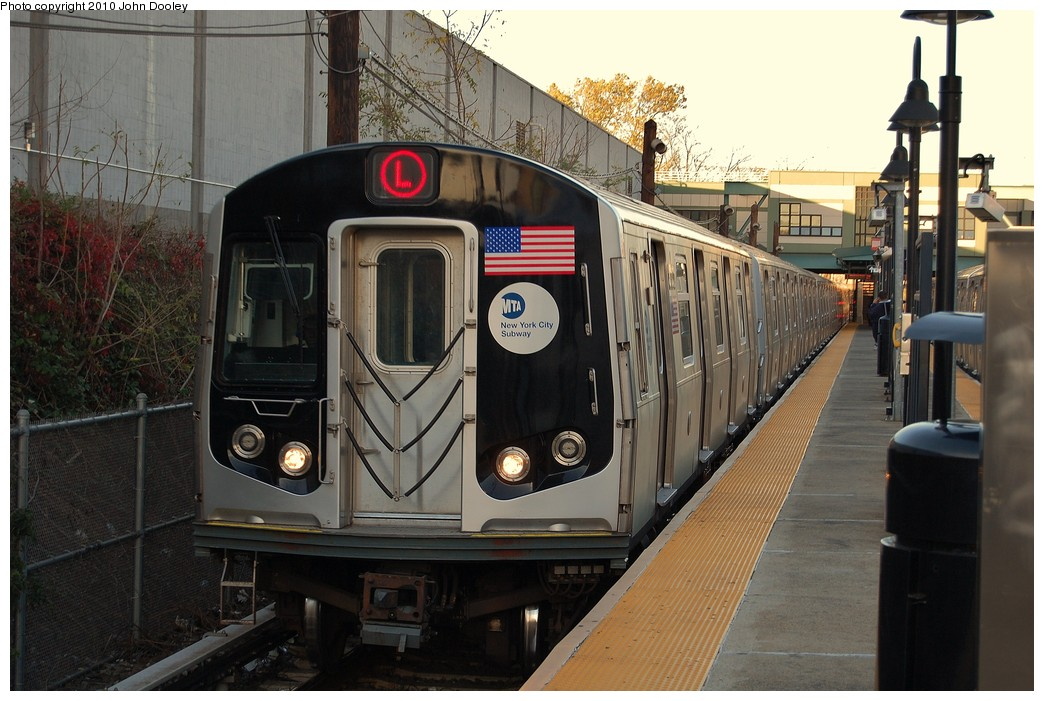 (237k, 1044x701)<br><b>Country:</b> United States<br><b>City:</b> New York<br><b>System:</b> New York City Transit<br><b>Line:</b> BMT Canarsie Line<br><b>Location:</b> East 105th Street <br><b>Route:</b> L<br><b>Car:</b> R-143 (Kawasaki, 2001-2002) 8313 <br><b>Photo by:</b> John Dooley<br><b>Date:</b> 10/28/2010<br><b>Viewed (this week/total):</b> 4 / 466
