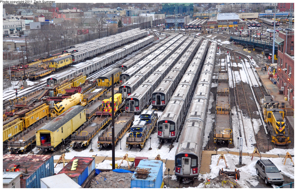 (415k, 1044x672)<br><b>Country:</b> United States<br><b>City:</b> New York<br><b>System:</b> New York City Transit<br><b>Location:</b> Westchester Yard<br><b>Photo by:</b> Zach Summer<br><b>Date:</b> 1/2/2011<br><b>Notes:</b> Visible are ballast loader/hoppers, weld car OW302, locomotives 70 & 56, and lots of R142A trainsets.<br><b>Viewed (this week/total):</b> 2 / 1625