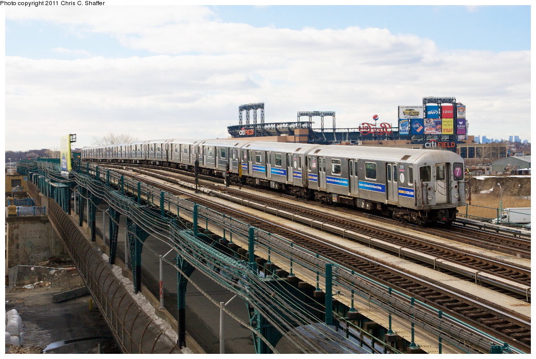 (297k, 1044x700)<br><b>Country:</b> United States<br><b>City:</b> New York<br><b>System:</b> New York City Transit<br><b>Line:</b> IRT Flushing Line<br><b>Location:</b> Main St. Tunnel Portal <br><b>Route:</b> 7<br><b>Car:</b> R-62A (Bombardier, 1984-1987)  2120 <br><b>Photo by:</b> Chris C. Shaffer<br><b>Date:</b> 2/8/2011<br><b>Notes:</b> View from Roosevelt Ave & College Point Blvd.<br><b>Viewed (this week/total):</b> 0 / 897