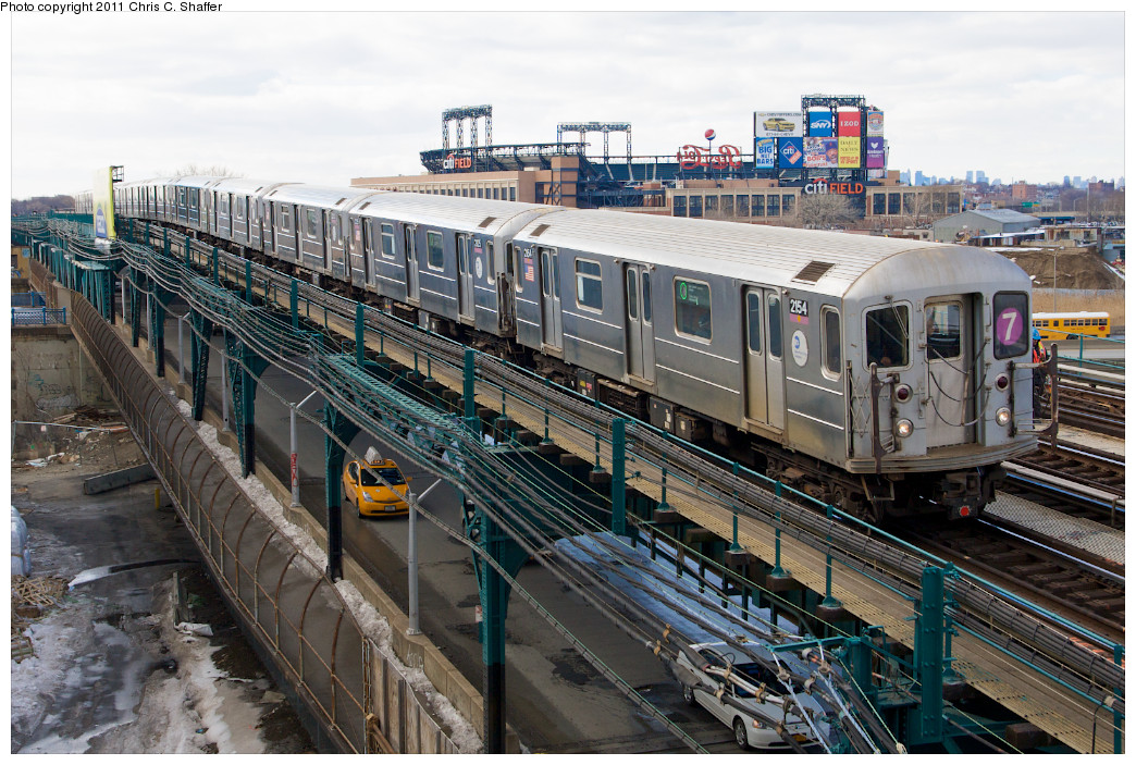 (314k, 1044x703)<br><b>Country:</b> United States<br><b>City:</b> New York<br><b>System:</b> New York City Transit<br><b>Line:</b> IRT Flushing Line<br><b>Location:</b> Main St. Tunnel Portal <br><b>Route:</b> 7<br><b>Car:</b> R-62A (Bombardier, 1984-1987)  2154 <br><b>Photo by:</b> Chris C. Shaffer<br><b>Date:</b> 2/8/2011<br><b>Notes:</b> View from Roosevelt Ave & College Point Blvd.<br><b>Viewed (this week/total):</b> 3 / 728