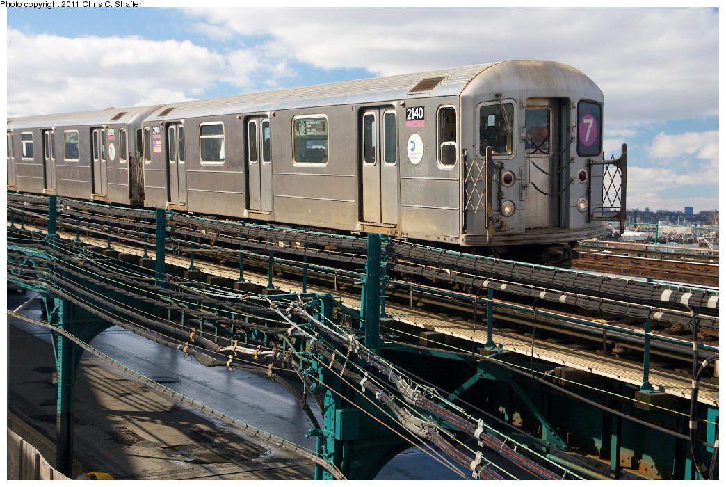 (311k, 1044x700)<br><b>Country:</b> United States<br><b>City:</b> New York<br><b>System:</b> New York City Transit<br><b>Line:</b> IRT Flushing Line<br><b>Location:</b> Main St. Tunnel Portal <br><b>Route:</b> 7<br><b>Car:</b> R-62A (Bombardier, 1984-1987)  2140 <br><b>Photo by:</b> Chris C. Shaffer<br><b>Date:</b> 2/8/2011<br><b>Notes:</b> View from Roosevelt Ave & College Point Blvd.<br><b>Viewed (this week/total):</b> 0 / 571