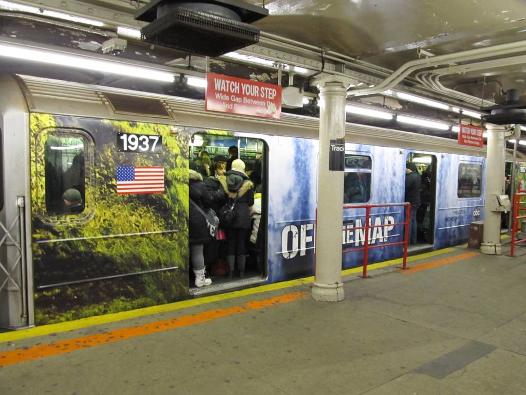 (127k, 1024x768)<br><b>Country:</b> United States<br><b>City:</b> New York<br><b>System:</b> New York City Transit<br><b>Line:</b> IRT Times Square-Grand Central Shuttle<br><b>Location:</b> Times Square <br><b>Route:</b> S<br><b>Car:</b> R-62A (Bombardier, 1984-1987)  1937 <br><b>Photo by:</b> Robbie Rosenfeld<br><b>Date:</b> 1/13/2011<br><b>Notes:</b> Off the Map TV show decals.<br><b>Viewed (this week/total):</b> 2 / 1316
