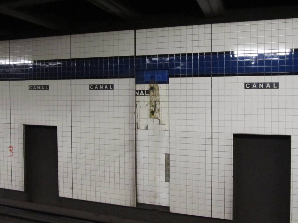(83k, 1024x768)<br><b>Country:</b> United States<br><b>City:</b> New York<br><b>System:</b> New York City Transit<br><b>Line:</b> IND 8th Avenue Line<br><b>Location:</b> Canal Street-Holland Tunnel <br><b>Photo by:</b> Robbie Rosenfeld<br><b>Date:</b> 1/12/2011<br><b>Notes:</b> Original IND tile and new renovated tile.<br><b>Viewed (this week/total):</b> 0 / 428