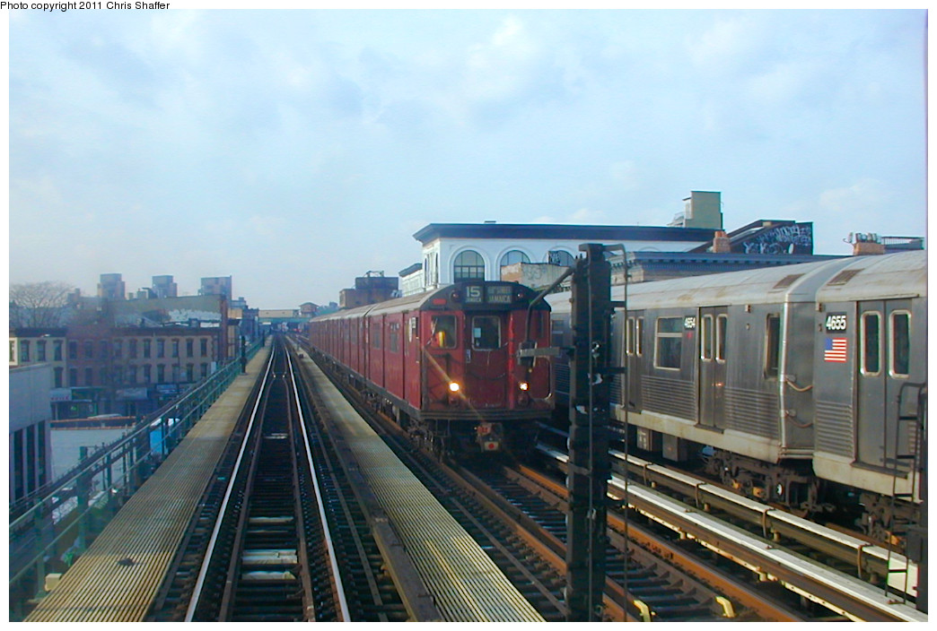(220k, 1044x704)<br><b>Country:</b> United States<br><b>City:</b> New York<br><b>System:</b> New York City Transit<br><b>Line:</b> BMT Nassau Street/Jamaica Line<br><b>Location:</b> Kosciuszko Street <br><b>Route:</b> Fan Trip<br><b>Car:</b> R-33 World's Fair (St. Louis, 1963-64) 9338 <br><b>Photo by:</b> Chris C. Shaffer<br><b>Date:</b> 12/8/2002<br><b>Notes:</b> With R-42 4654 / 4655<br><b>Viewed (this week/total):</b> 1 / 678