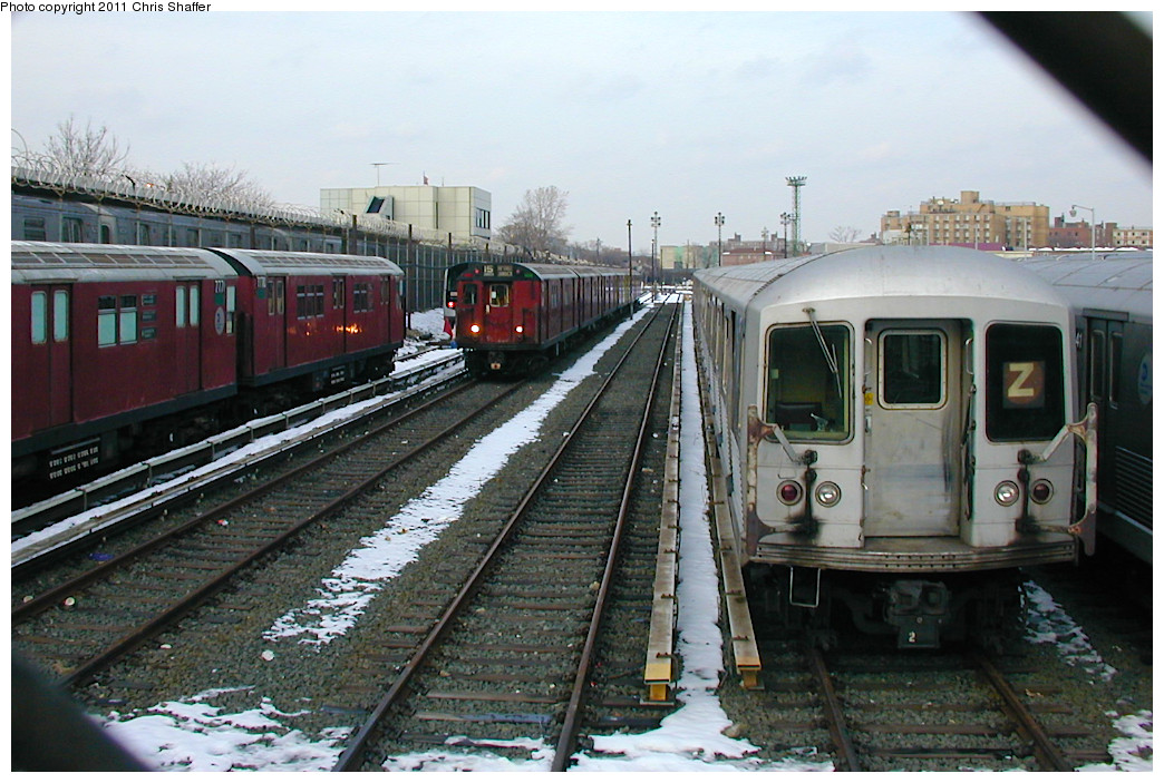 (256k, 1044x703)<br><b>Country:</b> United States<br><b>City:</b> New York<br><b>System:</b> New York City Transit<br><b>Location:</b> Rockaway Parkway (Canarsie) Yard<br><b>Route:</b> Fan Trip<br><b>Car:</b> R-33 World's Fair (St. Louis, 1963-64) 9338 <br><b>Photo by:</b> Chris C. Shaffer<br><b>Date:</b> 12/8/2002<br><b>Notes:</b> With R-42 (Z) and R26 7770/7771<br><b>Viewed (this week/total):</b> 0 / 1040