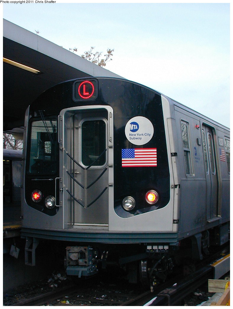 (206k, 788x1044)<br><b>Country:</b> United States<br><b>City:</b> New York<br><b>System:</b> New York City Transit<br><b>Line:</b> BMT Canarsie Line<br><b>Location:</b> Rockaway Parkway <br><b>Route:</b> L<br><b>Car:</b> R-143 (Kawasaki, 2001-2002) 8237 <br><b>Photo by:</b> Chris C. Shaffer<br><b>Date:</b> 12/8/2002<br><b>Viewed (this week/total):</b> 11 / 536