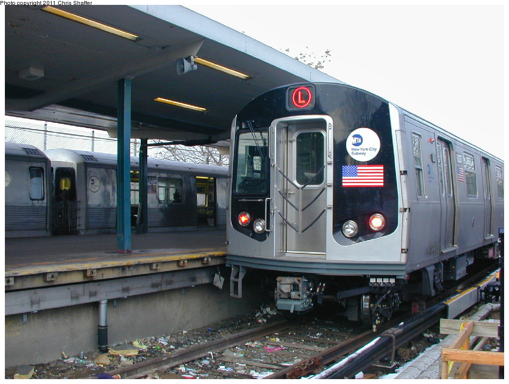 (263k, 1044x788)<br><b>Country:</b> United States<br><b>City:</b> New York<br><b>System:</b> New York City Transit<br><b>Line:</b> BMT Canarsie Line<br><b>Location:</b> Rockaway Parkway <br><b>Route:</b> L<br><b>Car:</b> R-143 (Kawasaki, 2001-2002) 8237 <br><b>Photo by:</b> Chris C. Shaffer<br><b>Date:</b> 12/8/2002<br><b>Notes:</b> With R42 4870<br><b>Viewed (this week/total):</b> 5 / 676