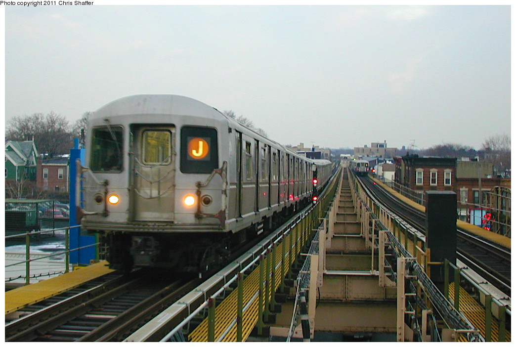 (226k, 1044x702)<br><b>Country:</b> United States<br><b>City:</b> New York<br><b>System:</b> New York City Transit<br><b>Line:</b> BMT Nassau Street/Jamaica Line<br><b>Location:</b> Alabama Avenue <br><b>Route:</b> J<br><b>Car:</b> R-40M (St. Louis, 1969)   <br><b>Photo by:</b> Chris C. Shaffer<br><b>Date:</b> 12/8/2002<br><b>Viewed (this week/total):</b> 5 / 910