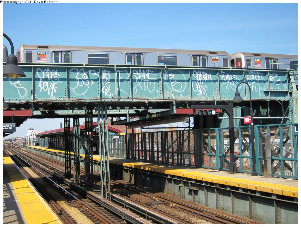 (299k, 1044x788)<br><b>Country:</b> United States<br><b>City:</b> New York<br><b>System:</b> New York City Transit<br><b>Line:</b> BMT Canarsie Line<br><b>Location:</b> Livonia Avenue <br><b>Route:</b> 3<br><b>Car:</b> R-62 (Kawasaki, 1983-1985)  1388 <br><b>Photo by:</b> David Pirmann<br><b>Date:</b> 4/9/2011<br><b>Notes:</b> View of IRT from Canarsie line platform.<br><b>Viewed (this week/total):</b> 4 / 1328
