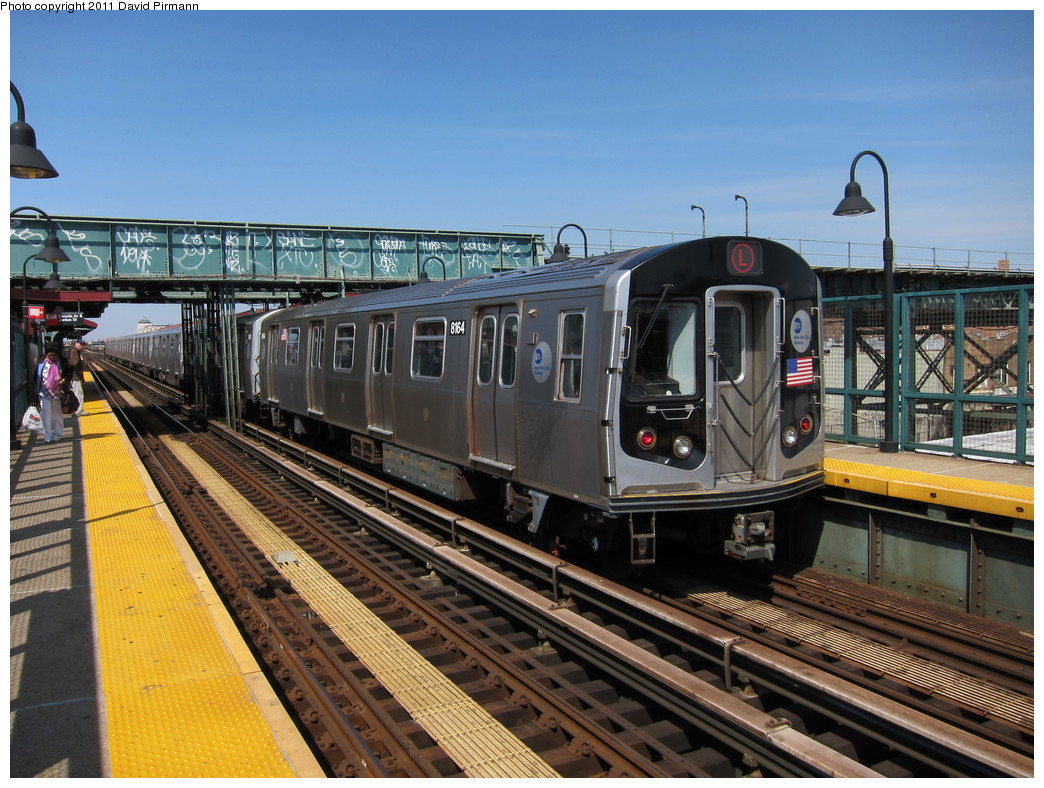 (255k, 1044x788)<br><b>Country:</b> United States<br><b>City:</b> New York<br><b>System:</b> New York City Transit<br><b>Line:</b> BMT Canarsie Line<br><b>Location:</b> Livonia Avenue <br><b>Route:</b> L<br><b>Car:</b> R-143 (Kawasaki, 2001-2002) 8164 <br><b>Photo by:</b> David Pirmann<br><b>Date:</b> 4/9/2011<br><b>Viewed (this week/total):</b> 0 / 424