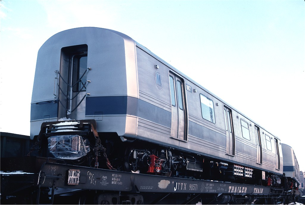 (145k, 1024x687)<br><b>Country:</b> United States<br><b>City:</b> Hoboken, NJ<br><b>System:</b> New York City Transit<br><b>Location:</b> Hoboken Yard <br><b>Car:</b> R-46 (Pullman-Standard, 1974-75) 887 <br><b>Photo by:</b> Ed McKernan<br><b>Collection of:</b> Joe Testagrose<br><b>Date:</b> 12/27/1976<br><b>Viewed (this week/total):</b> 0 / 240