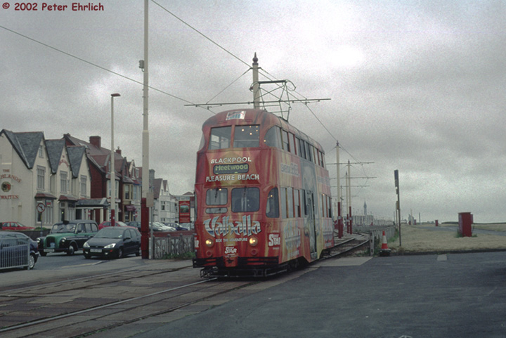 (126k, 720x481)<br><b>Country:</b> United Kingdom<br><b>City:</b> Blackpool<br><b>System:</b> Blackpool Transport<br><b>Car:</b> Blackpool Balloon (English Electric, 1934-1935)  720 <br><b>Photo by:</b> Peter Ehrlich<br><b>Date:</b> 6/30/2002<br><b>Notes:</b> Balloon 720 approaching Bispham outbound. This Valhalla advertising car features a skull around the doorways.<br><b>Viewed (this week/total):</b> 1 / 2851