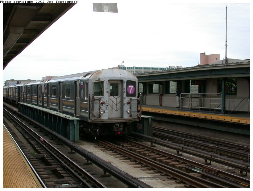 (113k, 820x620)<br><b>Country:</b> United States<br><b>City:</b> New York<br><b>System:</b> New York City Transit<br><b>Line:</b> IRT Flushing Line<br><b>Location:</b> 33rd Street/Rawson Street <br><b>Route:</b> 7<br><b>Car:</b> R-62A (Bombardier, 1984-1987)  2124 <br><b>Photo by:</b> Joe Testagrose<br><b>Date:</b> 6/4/2002<br><b>Viewed (this week/total):</b> 0 / 2405