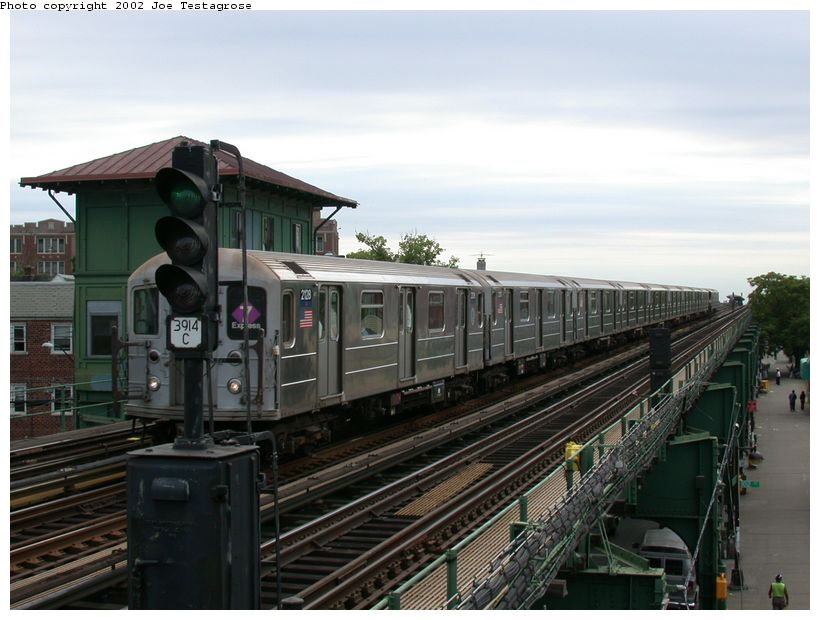 (115k, 820x620)<br><b>Country:</b> United States<br><b>City:</b> New York<br><b>System:</b> New York City Transit<br><b>Line:</b> IRT Flushing Line<br><b>Location:</b> 103rd Street/Corona Plaza <br><b>Route:</b> 7<br><b>Car:</b> R-62A (Bombardier, 1984-1987)  2128 <br><b>Photo by:</b> Joe Testagrose<br><b>Date:</b> 6/4/2002<br><b>Viewed (this week/total):</b> 0 / 3308