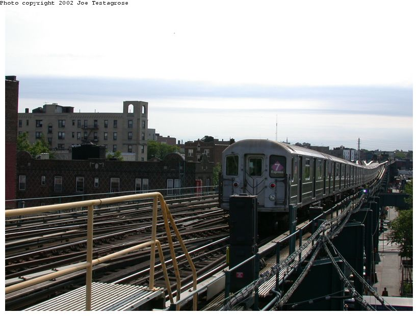 (117k, 820x620)<br><b>Country:</b> United States<br><b>City:</b> New York<br><b>System:</b> New York City Transit<br><b>Line:</b> IRT Flushing Line<br><b>Location:</b> 69th Street/Fisk Avenue <br><b>Route:</b> 7<br><b>Car:</b> R-62A (Bombardier, 1984-1987)  2128 <br><b>Photo by:</b> Joe Testagrose<br><b>Date:</b> 6/4/2002<br><b>Viewed (this week/total):</b> 0 / 2415