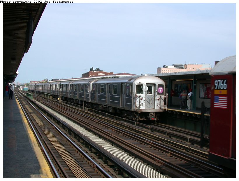 (116k, 820x620)<br><b>Country:</b> United States<br><b>City:</b> New York<br><b>System:</b> New York City Transit<br><b>Line:</b> IRT Flushing Line<br><b>Location:</b> 74th Street/Broadway <br><b>Route:</b> 7<br><b>Car:</b> R-62A (Bombardier, 1984-1987)  2142 <br><b>Photo by:</b> Joe Testagrose<br><b>Date:</b> 6/4/2002<br><b>Viewed (this week/total):</b> 4 / 2486
