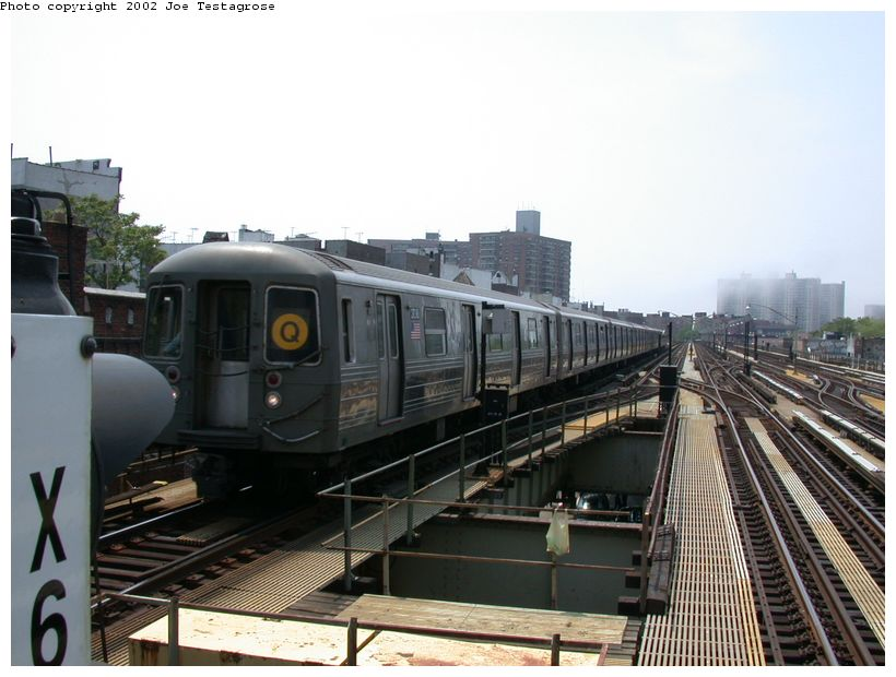 (115k, 820x620)<br><b>Country:</b> United States<br><b>City:</b> New York<br><b>System:</b> New York City Transit<br><b>Line:</b> BMT Brighton Line<br><b>Location:</b> Brighton Beach <br><b>Route:</b> Q<br><b>Car:</b> R-68 (Westinghouse-Amrail, 1986-1988)  2736 <br><b>Photo by:</b> Joe Testagrose<br><b>Date:</b> 5/27/2002<br><b>Viewed (this week/total):</b> 2 / 4807